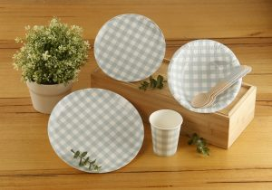 Some of Coles' new single use paper tableware range.